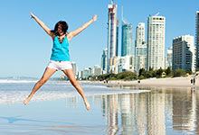Gold-Coast-Girl-Jumping-on-Beach